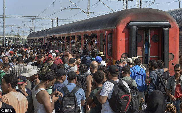 Hundreds of migrants on an overflowing platform in southern Macedonia desperately trying to get aboard trains travelling to Serbia